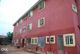 Two story building with another uncompleted building inside located at
