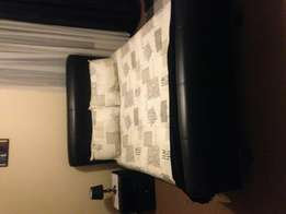 Leather sleigh bed, with dbl size second hand mattress if wanted