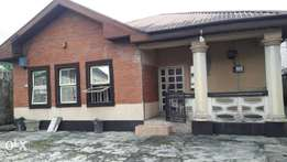 A Fenced 4 Bedroom Bungalow with 1 Room BQ on a tarred road network