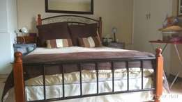 Antique double bed, metal and wood frame with Built on headboard