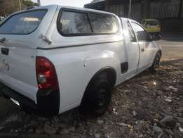 2011 White Opel Corsa 1.4 with a canopy for sale