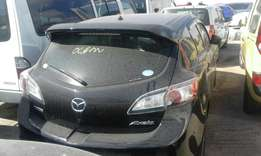 Just arrived Mazda axela with back spoiler 2010