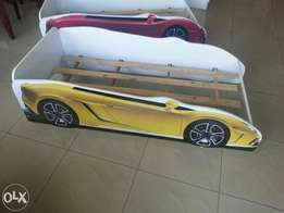 Kids Ferrari bed red or yellow in colour