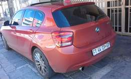 118i BMW 2013 1 series Orange color for Sale in Joburg