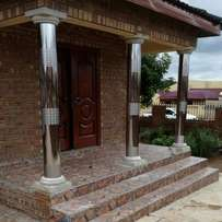 MANDLA stainless steel pillar covers and gutters