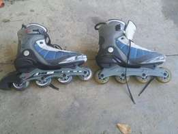 Size 12 and smaller pair roller blades for sale