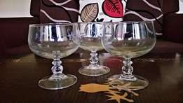 LARGE wine glasses with decorated stems.