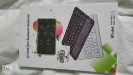 Multifunctional Thin Wireless Bluetooth 3.0 Keyboard With Touch pad..