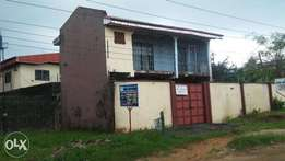 A one storey building , 4 flats in a one & half plot of land for sale