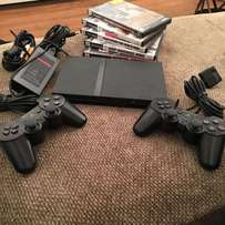 Ps2 slim consoles chipped with 2pads and 4games