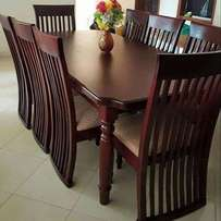 Classic Dinning tables and 5 seater leather cresent seats