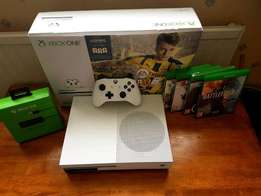 Xbox One S 500GB brand new comes with boxed plus four games