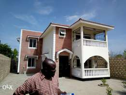 A 4bedroomed maisonette with an sq and an developed pilot at utange