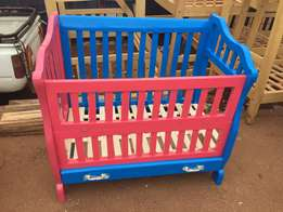 baby crib/coat standard size with a drawer.