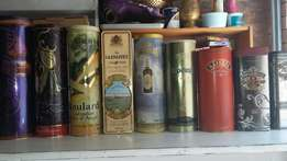 Numerous tins for display in a bar in good condition