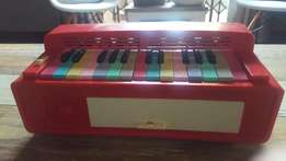 Very old plastic piano