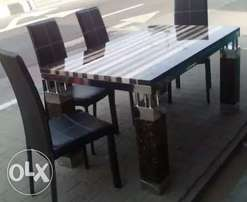This is marble dining table with six sitters