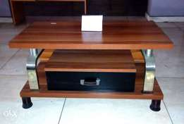 A brand new portable wooden T.V stand for sale. brown.