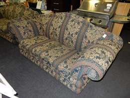 2 x Two Seater Material Couches
