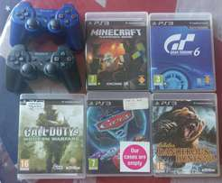 Playstation 3 with 2 controls and 5 games