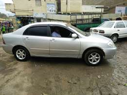 A Toyota NZE saloon car on sale.