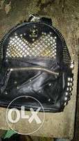 stone desined leather bag