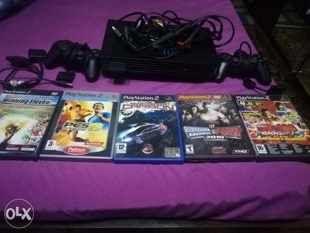 Playstation 2 with 4 games original and 2 controllers original
