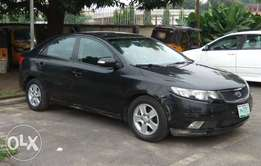 Registered kia cerato 2009 drives well with good shocks