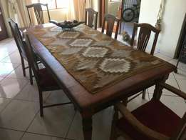Solid 8 seater yellow wood and chairs for sale