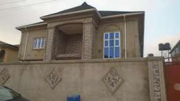 Tastefully 2 bedroom flat newly built upstairs all tiles at Baruwa Est