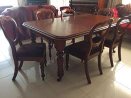 Antique mahogany table and chairs.