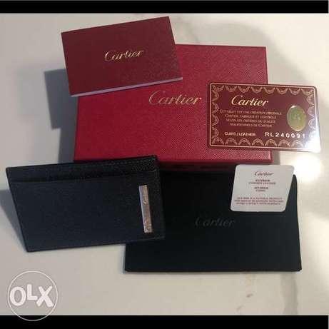 CARTIER (new in its gift bag) black genuine grained leather