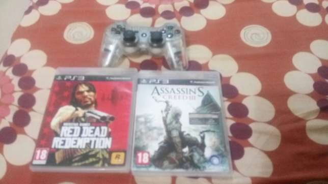 Ps3 controller and two games Awka South - image 1