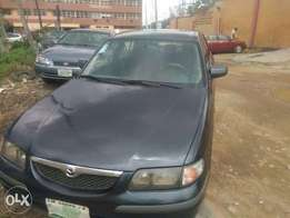 Very well maintained Year 2000 Mazda 626 with air-conditioner and DVD