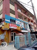 For sale fully occupied 8nos of 3bedroom flats office/shop in Gbagada