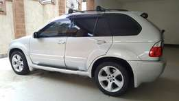 A BMW X5 2005 in perfect working condition with brand new wheels
