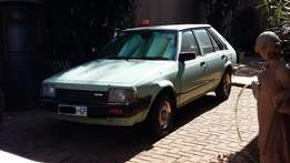 Mazda 323 1.3 in good condition with low kms'