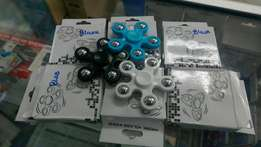 Amazing stylish fidget spinner in blue,black and white in a shop