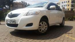 Well maintained  white Toyota belta 1000cc petrol automatic