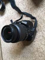 Nikon D5100 DSLR Camera with 18-55mm f/3.5-5.6 Auto Focus-S Nikkor Zoo