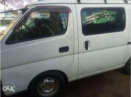 Nissan Caravan, white color, with carrier