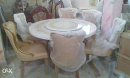 Set of round marble dining with six chairs