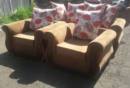 A brown 5 seater sofa