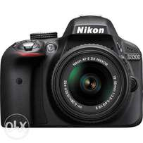 Nikon D3300 DSLR camera with 18-55mm lens box and accessories