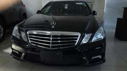 Mercedes Benz E 200. With double Sunroof.