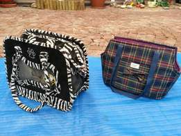 2 Carry handbags for small dogs.