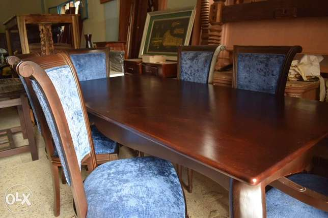 solid wood table with chairs