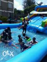 Trampolines water slides castles face painting clowns and acrobatics
