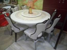 Round marble dinning table with y solid chairs