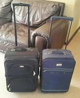 Two trolley bags/suitcases